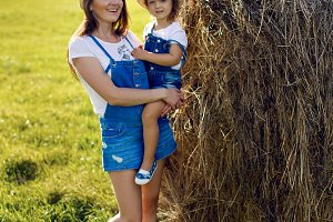 daughter with mom standing in the field