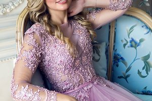 young sexy blonde girl in Lacy pink dress