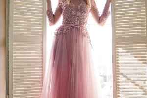 beautiful young girl in pink lace dress