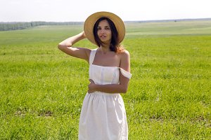 young girl in white dress and straw hat