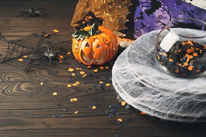 Halloween background with spider net and confetti