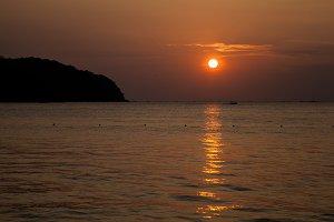 the large orange sunset in Malaysia