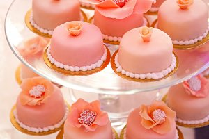 pink cupcakes on a glass stand
