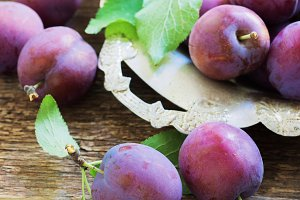plums on a wooden rustic table