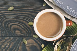 Wooden background with cup of coffee