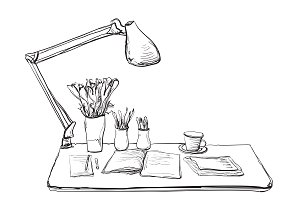 Workplace with notebook and lamp