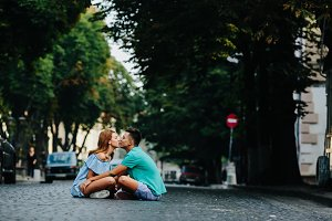 couple sitting on pavement square