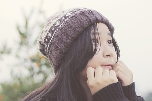 Young asian girl in winter clothing