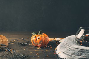 Halloween background with spider net and pumpkin
