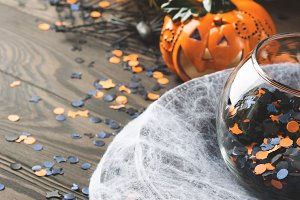 Halloween background with spider net and pumpkin. Vertical