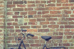Bicycle and a brick wall