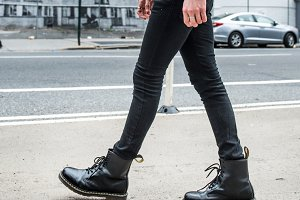 Man wear black stylish leather boots