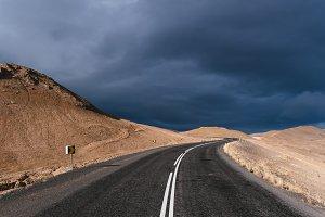 Mountain Road against dark Sky