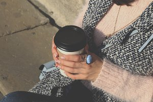 Woman in sweater with coffee cup