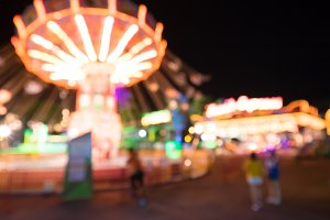 Blurred amusement park at night.