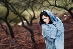 girl in the forest with a scarf