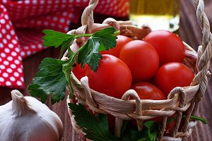 Fresh red tomato in basket