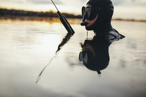 Spearfishing diver submerged