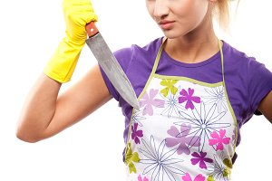 housewife in rubber yellow gloves