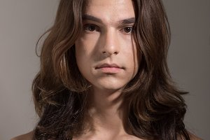 Transgender man woman young face