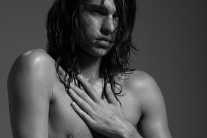 Young man shirtless nude wet hair
