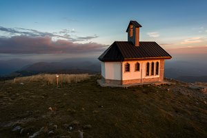Church on hill at sunset