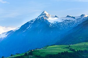 Spring snowy Alps mountain tops
