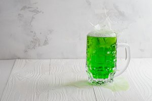 Glass of green beer with splash
