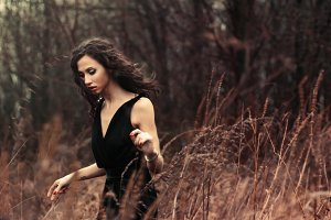 girl in a black dress in the field