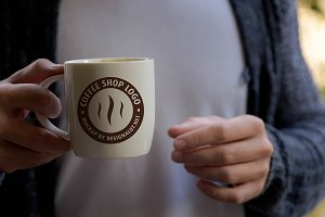 Man Holding Coffee Mug Mockup #2