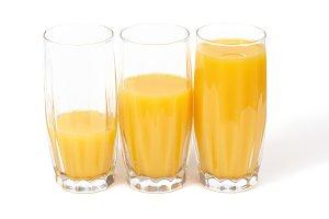 Three glasses with orange juice