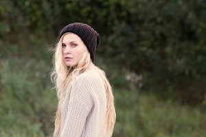 blond girl in a cap and a sweater
