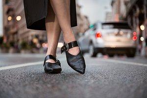 Female feet elegant leather shoes