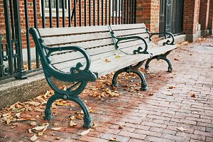 wooden bench on the street in autumn