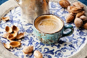 Coffee cup with almonds