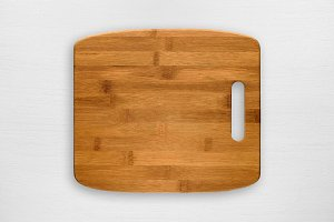 Chopping board on white wooden table