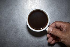 Holding Hot Black Coffee