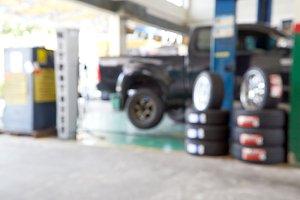 Blurred of car technician repairing tire