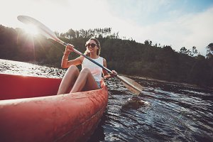 Young woman canoeing in a lake