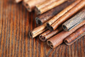 Cinnamon sticks on the wooden table
