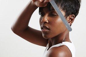 black woman make manicure