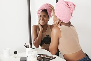 black woman with link towel on head