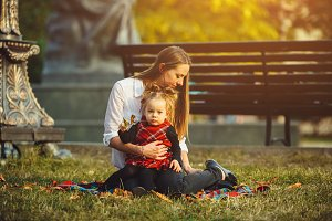 Mother and little daughter playing in a park