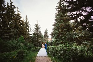 bride and groom standing on the background of the nature
