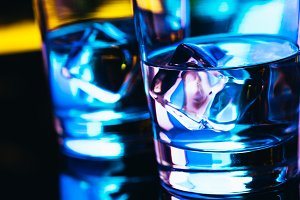 Two glasses of vodka with ice closeup