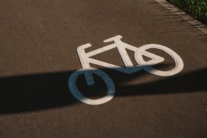 sign cyclist on the background of asphalt road