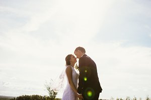 couple bride and groom on field background