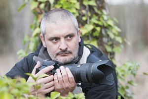 War photojournalist in a wild jungle.