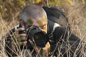 Camouflaged war photojournalist.