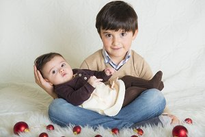 A child with his sister in Christmas